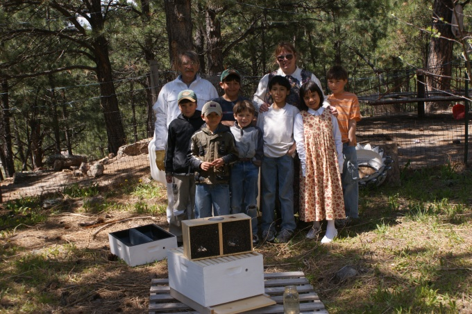 The family with their new bee hive